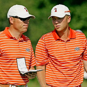 Oklahoma State assistant coach Brian Guetz and Talor Gooch talk at No. 16 during Wednesday final match play of the NCAA Men's Division 1 Championship between Alabama and Oklahoma State at Prairie Dunes Country Club in Hutchinson, Kan.