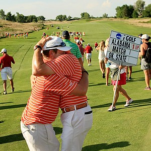 Oklahoma State assistant coach Brian Guetz tries to console Ian Davis after he lost his match to Alabama's Trey Mullinax during Wednesday final match play of the NCAA Men's Division 1 Championship between Alabama and Oklahoma State at Prairie Dunes Country Club in Hutchinson, Kan.
