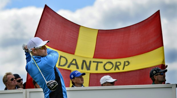 Sweden's Jens Dantorp watches the flight of his ball in front of a flag with his name on it during the first day of the Nordea Masters.