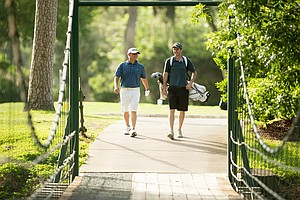A player and caddie during the U.S. Open Sectional Qualifier at Lakeside Country Club in Houston.