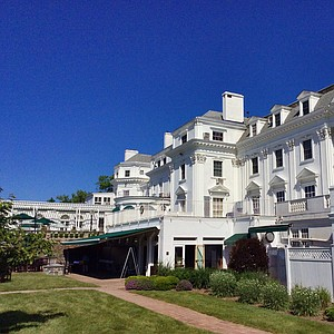Clear blue skies frame the clubhouse at Old Oaks Country Club in Purchase, N.Y., for 2014 U.S. Open sectional qualifying.