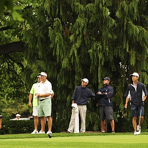 Todd White hits a tee shot as Michael Kim looks on during the U.S. Open sectional qualifier at Brookside Golf and Country Club in Columbus, Ohio.