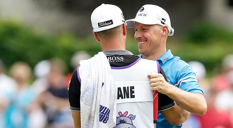Ben Crane celebrates with caddie Joel Stock after winning the 2014 FedEx St. Jude Classic at TPC Southwind in Memphis.
