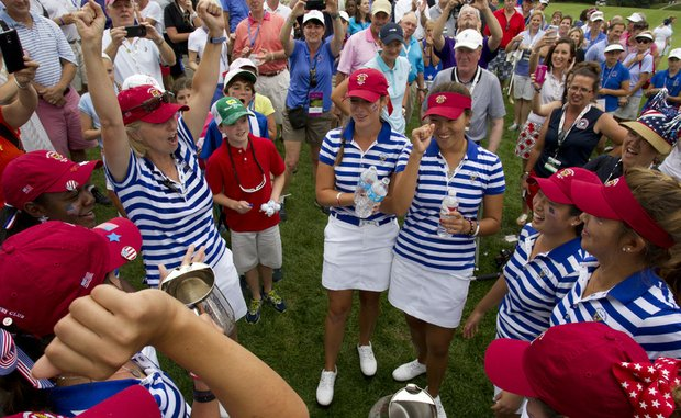 U.S. captain Ellen Port (left) celebrates with her team after regaining the Curtis Cup at St. Louis Country Club.