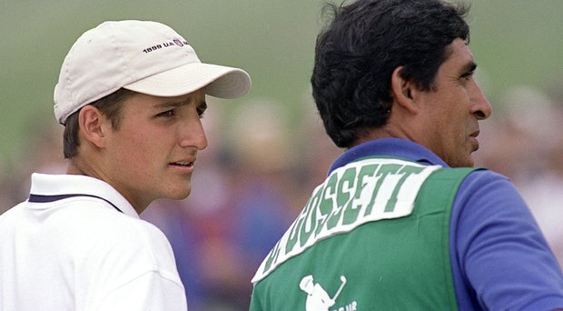 David Gossett listens to his caddie, Andy Martinez, during the 1999 U.S. Amateur at Pebble Beach.