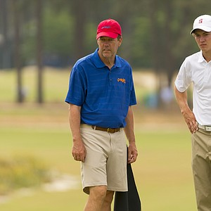 Maverick McNealy and his caddie, father Scott McNealy, during Monday's practice round for the 2014 U.S. Open at Pinehurst No. 2.