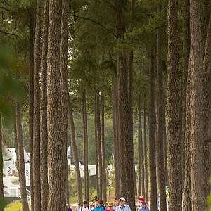 Fans walk along the cart path during Monday's practice round for the 2014 U.S. Open at Pinehurst No. 2.