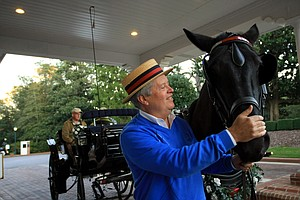 Frank Riggs of Carriage Tours of Pinehurst Village, Inc., with his horse Shiloh in the Pinehurst Village.