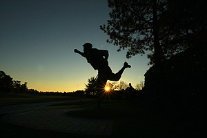 Payne Stewart statue is silhouetted against the morning sky at Pinehurst Resort.