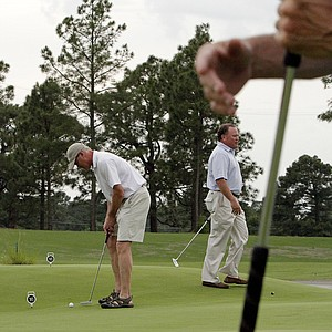 Rich Rames putts during a competition of Bellerive Country Club members on a recent outing to Pinehurst.