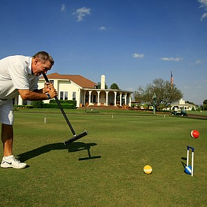 Danny Honeycutt demonstrates how to hit a jump shot on the Pinehurst croquet fields.