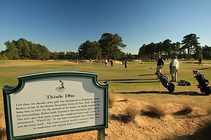 "Thistle Dhu putting course, adjacent to Course No. 4 at Pinehurst Resort. James Barber, owner of the Barber Steamship Links of New York, built his home, Thistle Dhu, in Pinehurst in 1919. On its grounds, he constructed the first miniature golf course in America. The story goes that upon first seeing the home and course, he pronounced, ""This'll Do."" It was translated into Thistle Dhu."