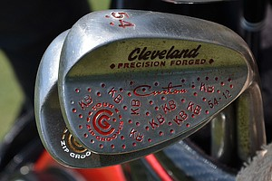 Bradley's Cleveland Forged 588 sand wedge, spotted at Pinehurst for the 2014 U.S. Open, has lots of custom stamping.