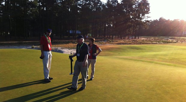 Chris Hartwiger, Pat O'Brien and Kimberly Erusha, all with USGA Green Section, at the seventh green on Wednesday morning at Pinehurst No. 2.