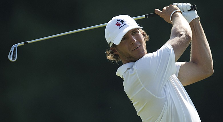 Canada's Garrett Rank leads the 2014 Monroe Invitational by two after back-to-back 66s.
