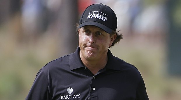 Phil Mickelson, shown during the first round of the 2014 U.S. Open at Pinehurst, reportedly won't be charged in regard to an investigation of Clorox shares trading, but remains linked to the federal probe.