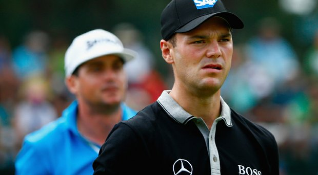 Martin Kaymer (right) and Keegan Bradley walk off the 13th tee during the second round of the U.S. Open at Pinehurst.
