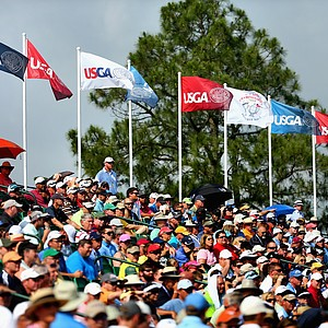 Patrons watch play from a grandstand on the 18th hole during the second round of the U.S. Open at Pinehurst No. 2.