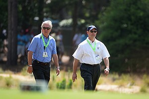 President, Thomas O'Toole, Jr. (left) walks with Mike Davis, Executive Director of the USGA, during the third round of the U.S. Open at Pinehurst No. 2.