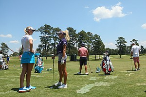 Some of the player's for the U.S. Women's Open practice on the range prior to Sunday's final round of the 2014 U.S. Open at Pinehurst No. 2.