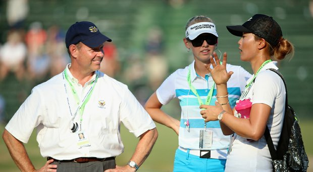 Michelle Wie talks to USGA Executive Director Mike Davis and fellow LPGA player Jessica Korda while preparing for the 2014 U.S. Women's Open at Pinehurst No. 2 by walking the course during the final round of the men's championship.