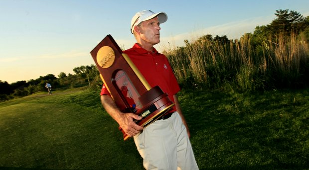 Mike McGraw, shown with the 2014 NCAA Championship trophy, was hired as the head men's coach at Baylor Monday after spending last season as an assistant at Alabama.
