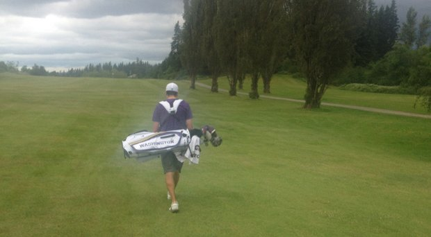 Tyler Salsbury walking Enumclaw Golf Course during his 13-under 57 round on June 19.
