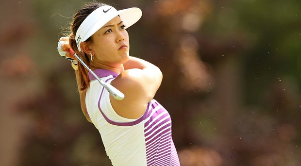 Michelle Wie is using a full bag of Nike equipment at the U.S. Women's Open. She holds a share of the lead after 54 holes.