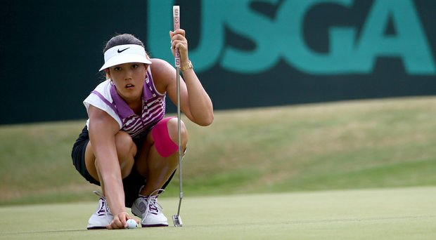 Michelle Wie lines up a putt on the 13th hole during the third round of the U.S. Women's Open at Pinehurst.