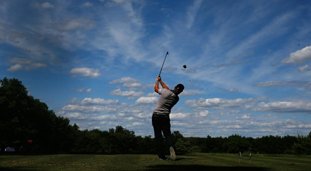 Ryan Moore watches his tee shot on the 11th hole during the third round of the Travelers Championship.