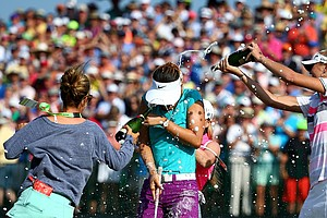 Michelle Wie is sprayed with champagne after the final round of the U.S. Women's Open at Pinehurst.