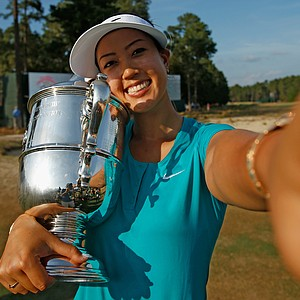 Michelle Wie takes a simulated selfie after her two-stroke victory at the U.S. Women's Open at Pinehurst.
