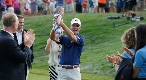 Kevin Streelman holds his daughter Sophia after winning the 2014 Travelers Championship. The victory moved Streelman to 36th in the Official World Golf Ranking.