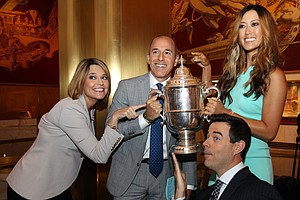 Michelle Wie, winner of the U.S. Women's Open, poses for a photo with NBC 'Today Show' hosts Savannah Guthrie, Matt Lauer and Carson Daly before appearing on the show during her media tour on Tuesday in New York City.