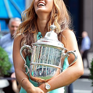 Michelle Wie, winner of the U.S. Women's Open, reacts while appearing on Fox's 'Fox and Friends' show during her media tour Tuesday in New York City.