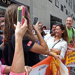 Michelle Wie, winner of the U.S. Women's Open, poses for photos with fans after appearing on NBC's the 'Today Show' during her media tour Tuesday in New York City.