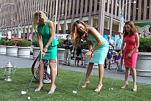 Michelle Wie, winner of the U.S. Women's Open, shows off her chipping skills with 'Fox and Friends' hosts Elisabeth Hasselbeck (left) and Maria Molina during Wie's media tour Tuesday in New York City.