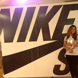 Michelle Wie poses with the U.S. Women's Open trophy at a Nike store in New York City on Tuesday.