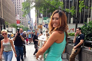 Michelle Wie on the streets of New York City (near the Avenue of the Americas) as she made a media tour of the city.