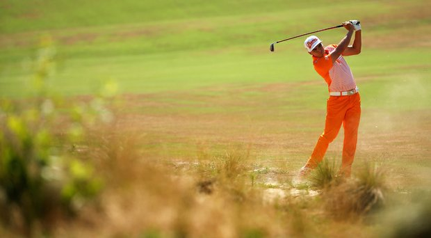 Rickie Fowler hits an approach shot on the fourth hole during the final round of the U.S. Open at Pinehurst.