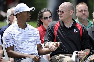Tiger Woods at the opening ceremonies on the eve of the PGA Tour's 2014 Quicken Loans National.