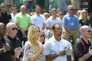 Tiger Woods and girlfriend Lindsey Vonn at the opening ceremonies on the eve of the PGA Tour's 2014 Quicken Loans National.