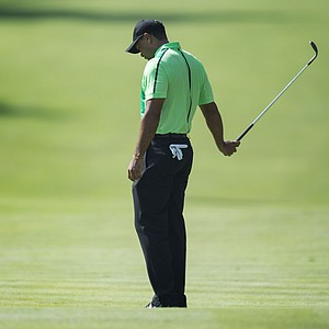 Tiger Woods reacts after a chip shot during the first round of the Quicken Loans National at Congressional Country Club.