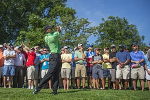 Tiger Woods hits from the rough during the first round of the Quicken Loans National at Congressional.