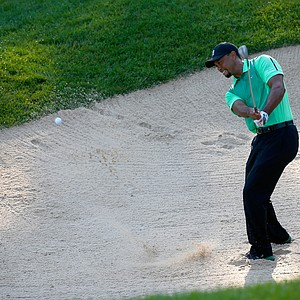 Tiger Woods hits out of the sand trap on the 10th hole during a first round of the Quicken Loans National at Congressional.