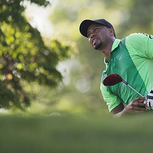 Tiger Woods reacts after teeing off during the first round of the Quicken Loans National at Congressional Country Club.