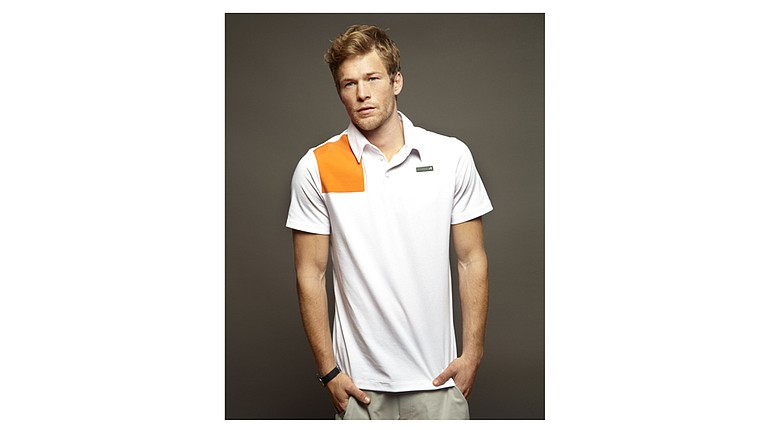 The Dudley polo features a three-button placket with orange color blocking.