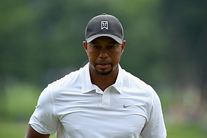 Tiger Woods walks off the second hole during the second round of the Quicken Loans National at Congressional.