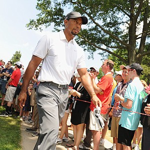 Tiger Woods walks off the third hole during the second round of the Quicken Loans National at Congressional.