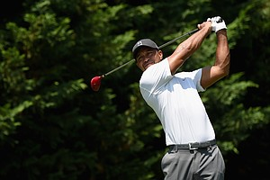 Tiger Woods watches his tee shot on the fifth hole during the second round of the Quicken Loans National at Congressional.